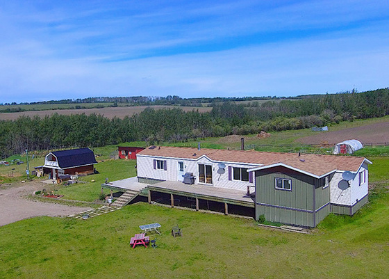 156 Acres of Premium Farm Land with Residence and Outbuildings - Montney, BC