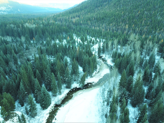 Large Creekfront Acreage Less Than an Hour from Kelowna